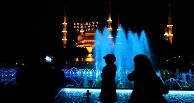 People taking pictures in front of the Blue Mosque on the first day of Ramadan in the Sultanahmet district of Istanbul, May 27.