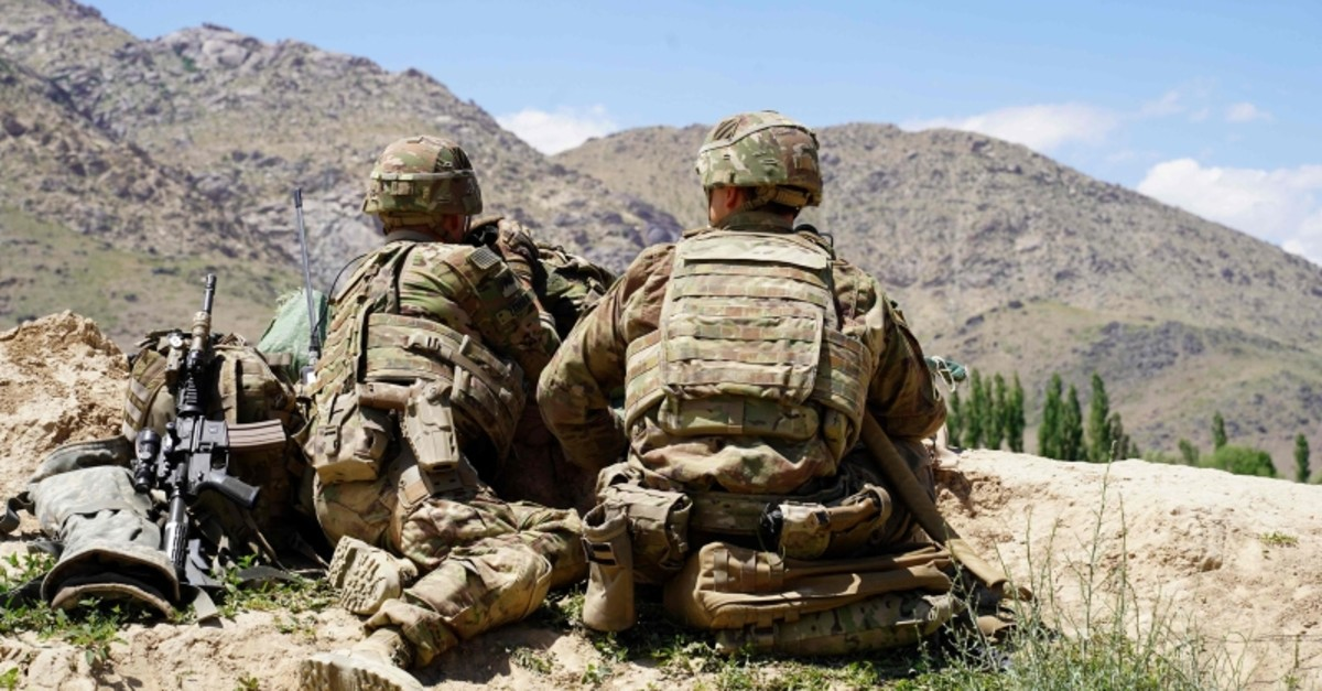 In this file photo taken on June 6, 2019, US soldiers look out over hillsides during a visit of the commander of US and NATO forces in Afghanistan General Scott Miller at the Afghan National Army (ANA) checkpoint in Nerkh district of Wardak province.