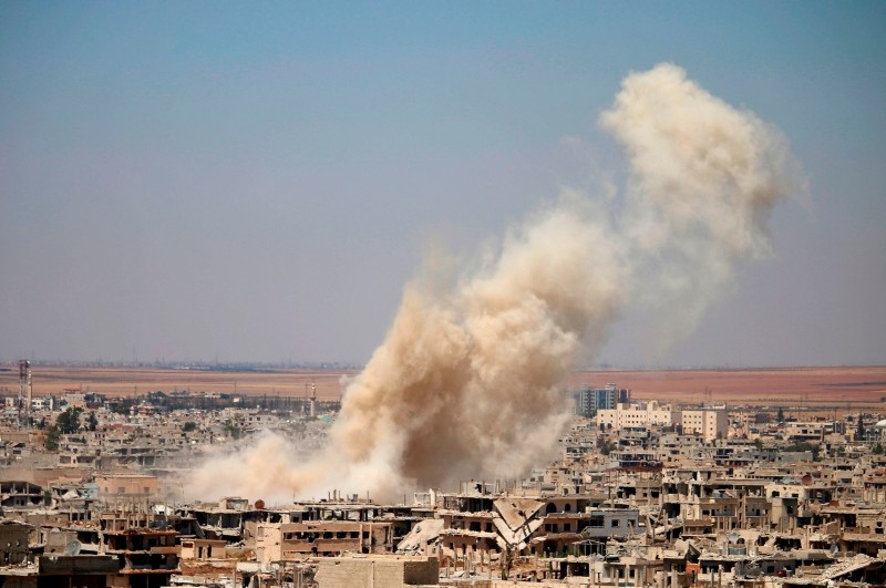 Smoke rises above opposition held areas of Daraa during an airstrike by Assad regime forces, on June 25, 2018. (AFP Photo)