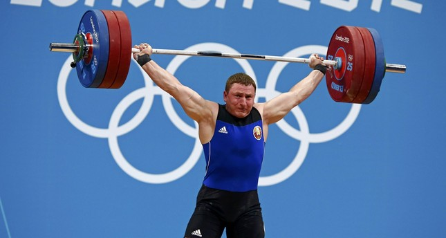 Belarus' Mikalai Novikau lifts on the men's 85Kg group B weightlifting competition at the ExCel venue at the London 2012 Olympic Games August 3, 2012.       (REUTERS Photo)