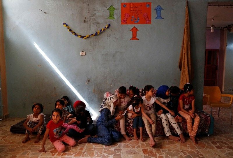 Syrian orphans from Aleppo sit as they pass time in an orphanage in Jarablus, northern Syria, Wednesday, May 30, 2018. (AP Photo)