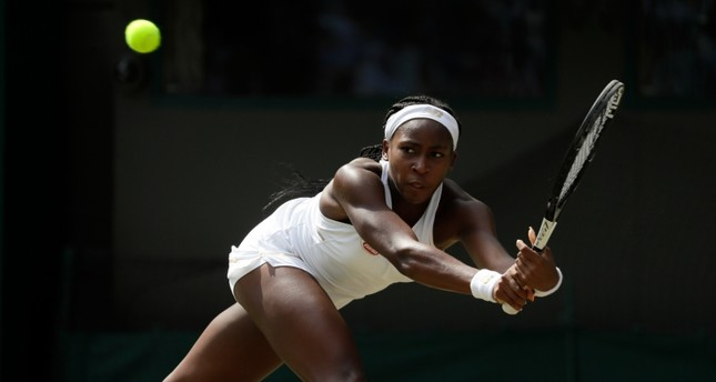 United States' Cori Coco Gauff returns the ball to Romania's Simona Halep in a women's singles match during day seven of the Wimbledon Tennis Championships in London, Monday, July 8, 2019. AP Photo