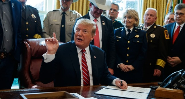 President Donald Trump speaks about border security in the Oval Office of the White House, Friday, March 15, 2019, in Washington. (AP Photo)