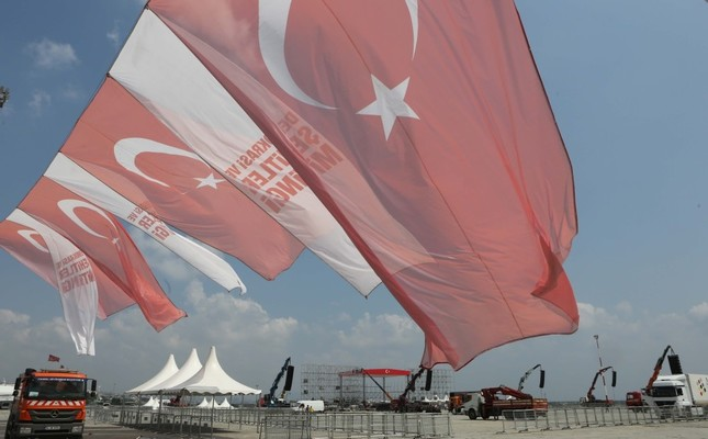 Turkish flags fly next to a banner reading Democracy and Martyrs Rally at Yenikapı on Friday. Yenikapı will host a diverse crowd of people, including leaders of opposition parties, as well as the ruling party. Photo - Sabah / Uğur Yıldırım
