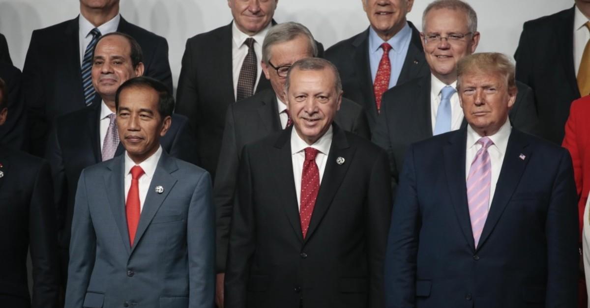 President Erdou011fan poses with U.S. President Donald Trump at G20 leaders summit in Osaka, Japan, June 28, 2019.