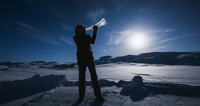 Terje Lsungset, the founder and artistic director of the Ice Music Festival, tests a musical instrument made of ice outside his workshop ahead of the festival on Feb. 2, 2018. (AFP Photo)