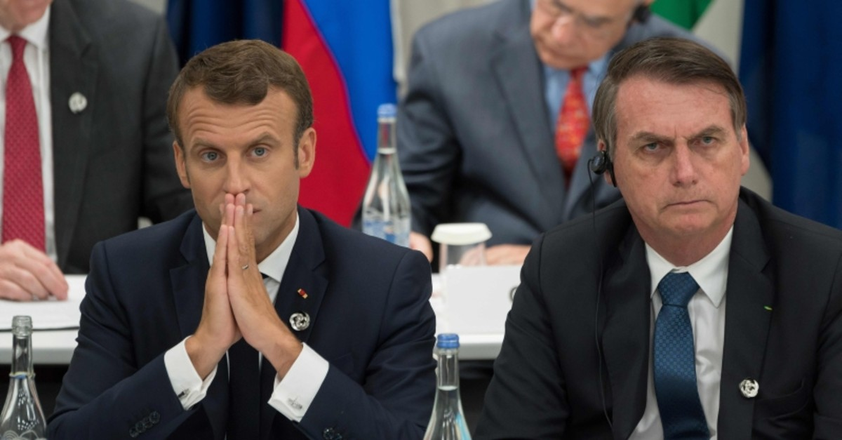 This June 28, 2019, file photo, shows France's President Emmanuel Macron, left, and Brazil's President Jair Bolsonaro attending a meeting on the digital economy at the G-20 Summit in Osaka, Japan. (AFP Photo)