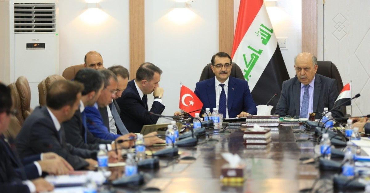 Energy and Natural Resources Minister Fatih Du00f6nmez (L) during a meeting with Iraq's Oil Minister Thamer Ghadhban (R), Baghdad, Iraq, Aug. 28, 2019.