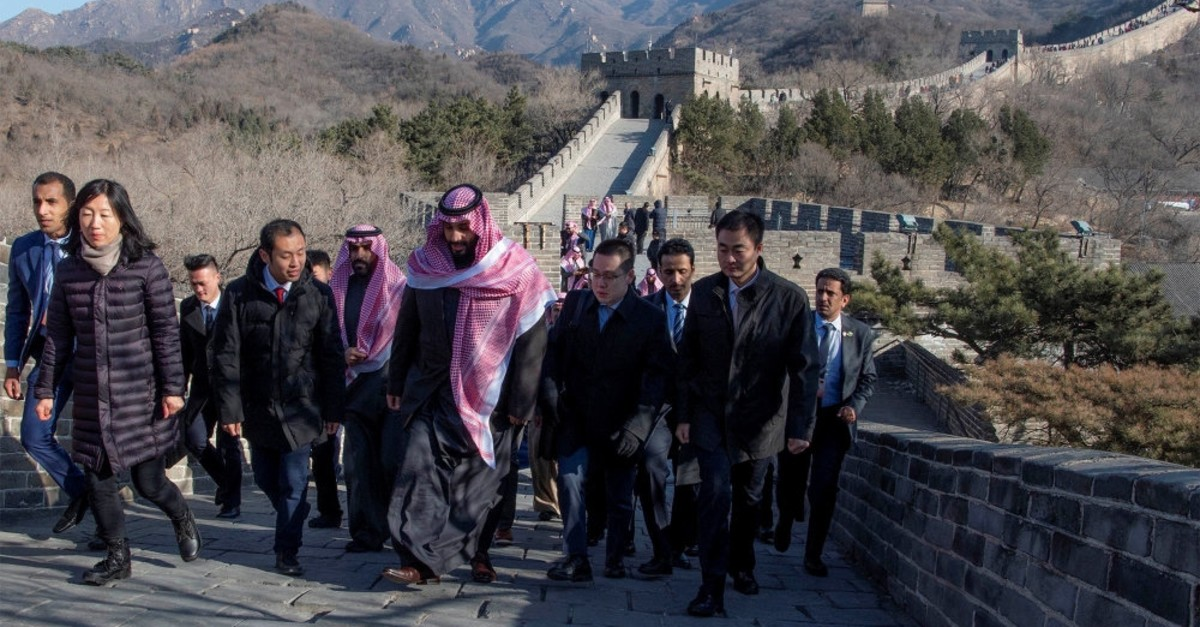 Saudi Arabia's Crown Prince Mohammed bin Salman walks with officials during his visit to the Great Wall of China in Beijing, Feb. 21, 2019.