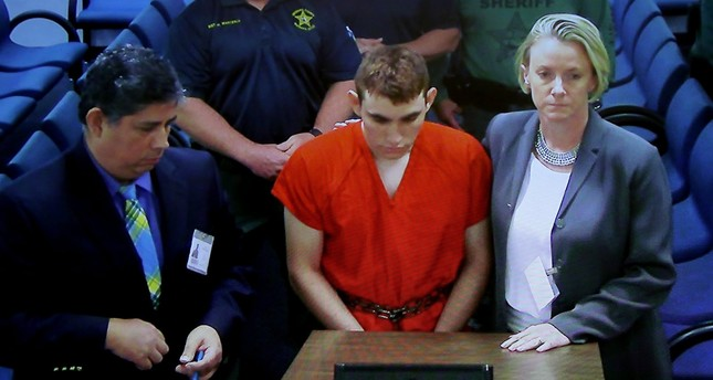School shooter Nikolas Cruz (C) makes a video appearance in Broward County court before Judge Kim Theresa Mollica, Fort Lauderdale, Florida, February 15, 2018. (EPA Photo)
