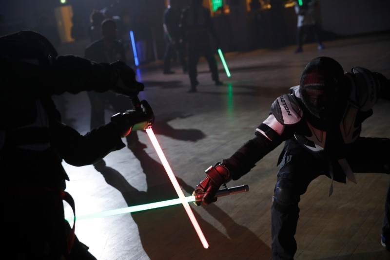 In this Sunday, Feb. 10, 2019, photo, competitor battles during the national lightsabers tournament in Beaumont-sur-Oise, north of Paris. (AP Photo)