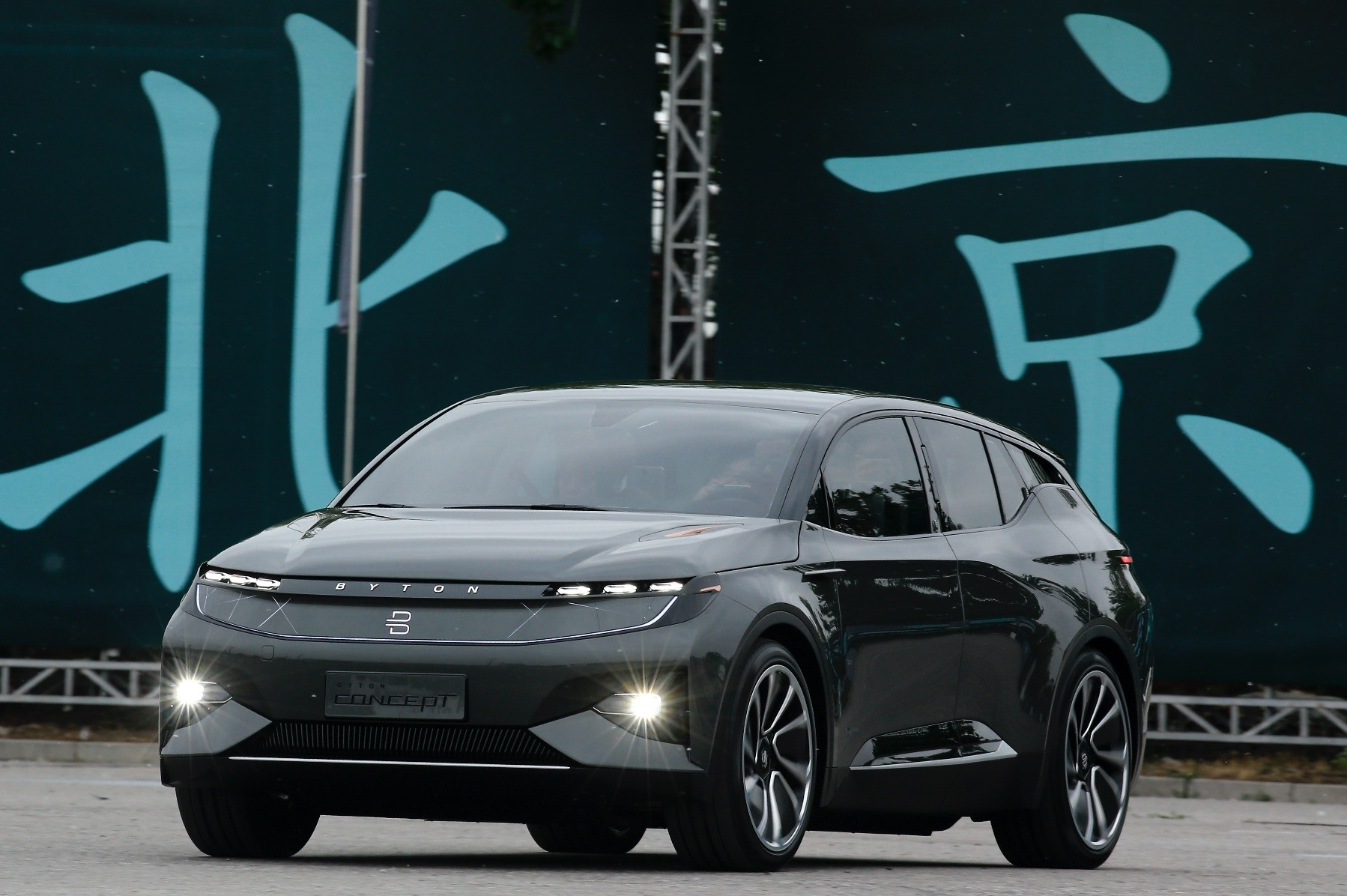 A BYTON electric concept car is driven by invited guests and journalists during a test drive event ahead of the Auto China 2018 automotive exhibition in Beijing.