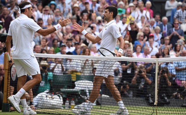Djokovic shakes hands with Federer after his victory in the men's singles final in Wimbledon, July 14, 2019.