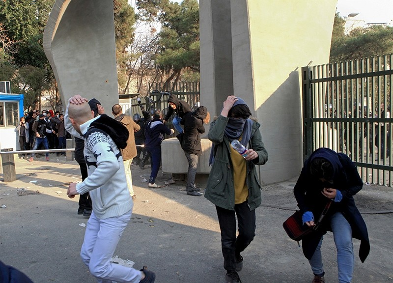 In this photo taken Dec. 30, 2017, by an individual not employed by the Associated Press and obtained outside Iran, university students run away from police during an anti-government protest inside Tehran University, in Tehran, Iran. (AP Photo)