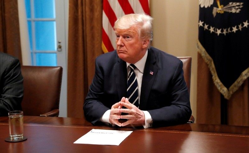 U.S. President Donald Trump awaits the start of a meeting with members of the U.S. Congress at the White House in Washington, July 17, 2018. (REUTERS Photo)