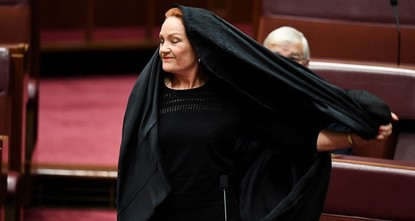 pAn Australian senator who a month ago provoked an angry backlash by wearing a burqa in Parliament urged lawmakers on Thursday to ban full-face Islamic coverings in public places./p  pPauline...