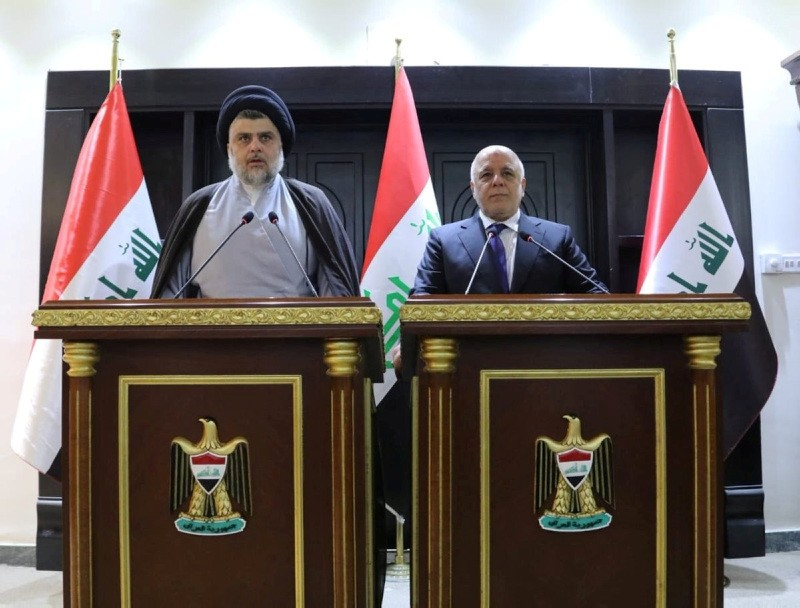 Iraqi Shiite cleric Moqtada al-Sadr, left, speaks during a news conference with Iraqi prime Minister Haider al-Abadi in Baghdad, Iraq, May 20, 2018. (Reuters Photo)
