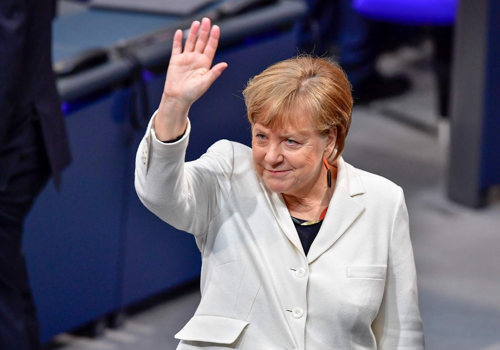 German Chancellor Angela Merkel waves as she arrives to attends the session for the election of the German Chancellor at the Bundestag (lower house of parliament) on March 14, 2018 in Berlin. (AFP Photo)