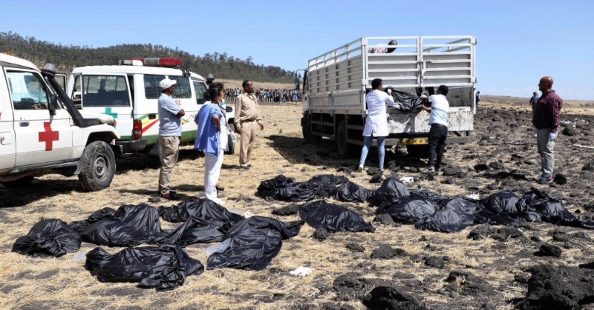 Rescuers remove body bags from the scene of an Ethiopian Airlines flight that crashed shortly after takeoff at Hejere near Bishoftu, or Debre Zeit, some 50 kilometers (31 miles) south of Addis Ababa, in Ethiopia Sunday, March 10, 2019. (AP Photo)