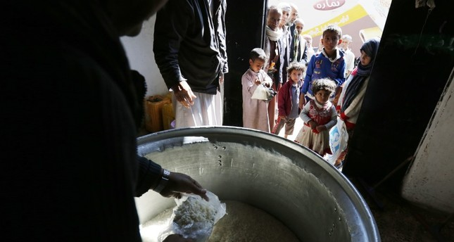 Conflict-ridden Yemenis receive local charity-provided food rations in Sana'a, Yemen, Nov. 12.