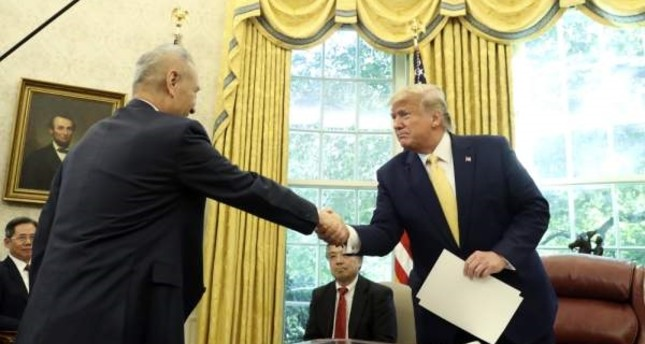 President Donald Trump shakes hands with Vice Premier Liu He in the Oval Office of the White House in Washington, Oct. 11, 2019. (AP Photo)