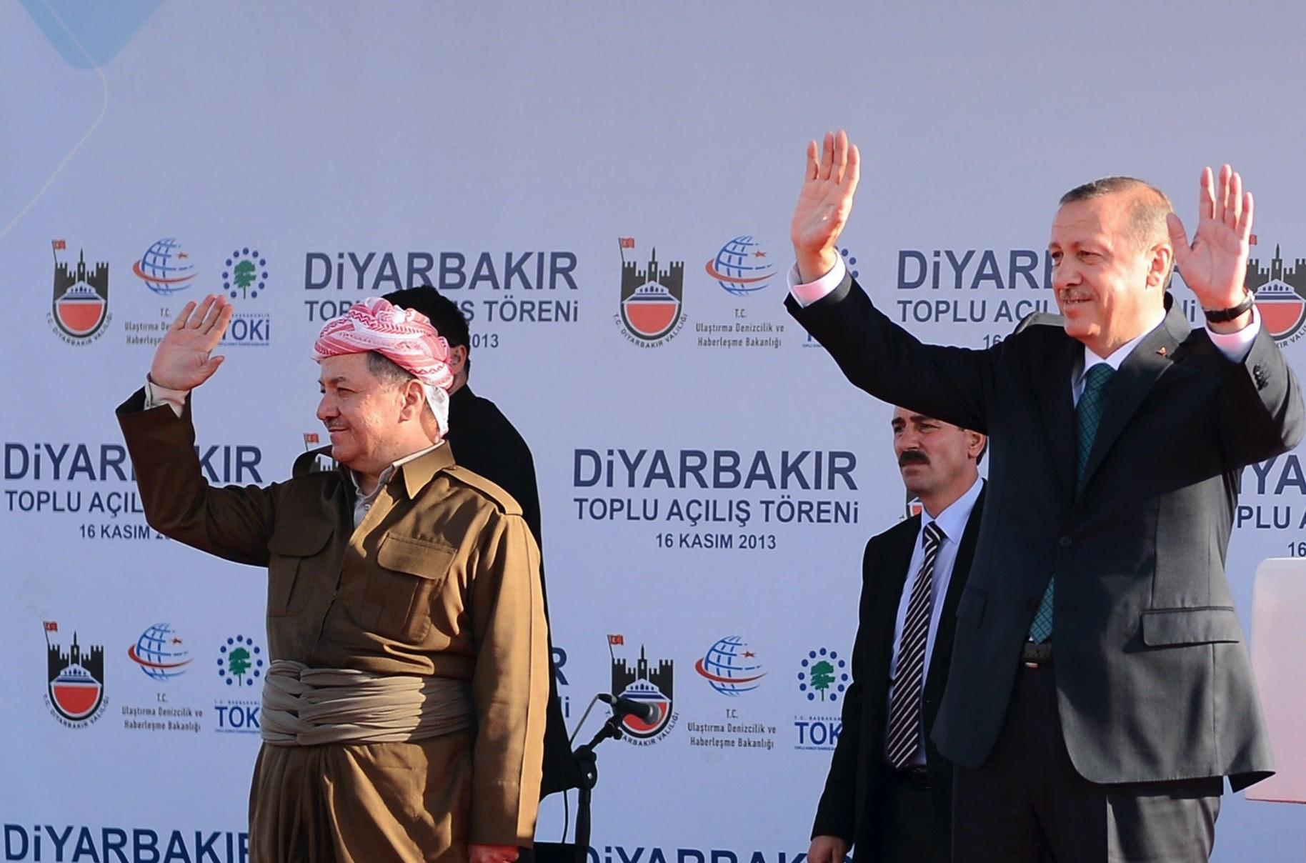 President Recep Tayyip Erdou011fan and President Masoud Barzani of the Iraqi Kurdistan Regional Government (KRG), greet the crowd during an opening in Diyarbaku0131r on Nov. 16, 2013.