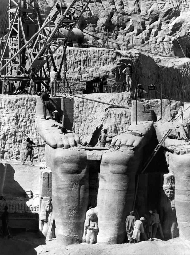 Egyptian workers dismantling Ramses II statues to be moved to the new site of the twin temples of Abu Simbel.
