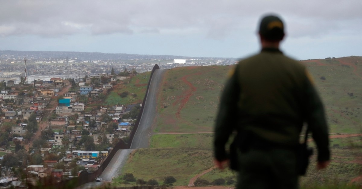 In this Feb. 5, 2019, file photo, Border Patrol agent Vincent Pirro looks on near a border wall that separates the cities of Tijuana, Mexico, and San Diego, in San Diego. (AP Photo)