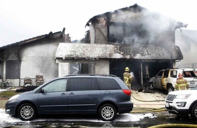 Firefighters work the scene of a deadly plane crash in the residential neighborhood of Yorba Linda, Calif., Sunday, Feb. 3, 2019. (AP Photo)