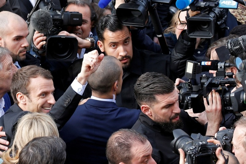 Emmanuel Macron (L), flanked by Alexandre Benalla (top), head of security, waves as he arrives to visit the birthplace of novelist Alexandre Dumas in France, March 17, 2017. (REUTERS Photo)