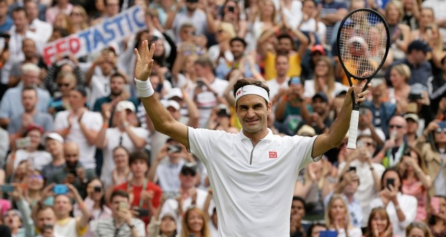 Switzerland's Roger Federer celebrates after beating Lucas Pouile of France in a Men's singles match during day six of the Wimbledon Tennis Championships in London, Saturday, July 6, 2019. (AP Photo)