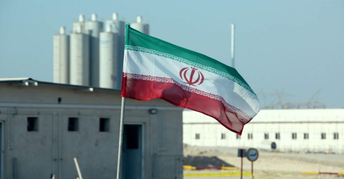 An Iranian flag flutters in Iran's Bushehr nuclear power plant, during an official ceremony to kick-start works on a second reactor at the facility, Nov. 10, 2019. (AFP Photo)