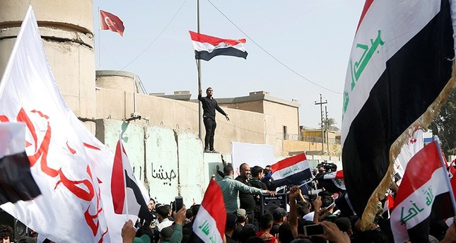 Supporters of Iraqi Shiite cleric Muqtada al-Sadr shout slogans during an anti-Turkey protest in front of the Turkish embassy in Baghdad, Iraq October 18, 2016. Reuters Photo