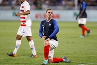 Griezmann says staying at Atletico Madrid