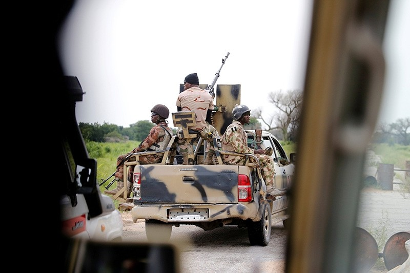 A Nigerian army convoy vehicle drives ahead with an anti-aircraft gun, on its way to Bama, Borno State, Nigeria Aug. 31, 2016. (Reuters Photo)