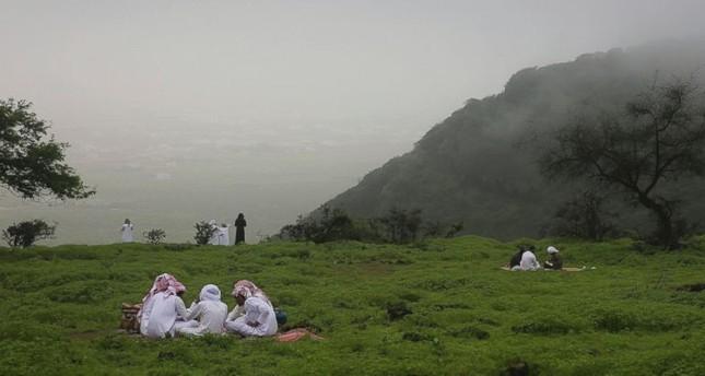 People picnic in the Jabal Ayoub mountains north of Salalah, Oman.