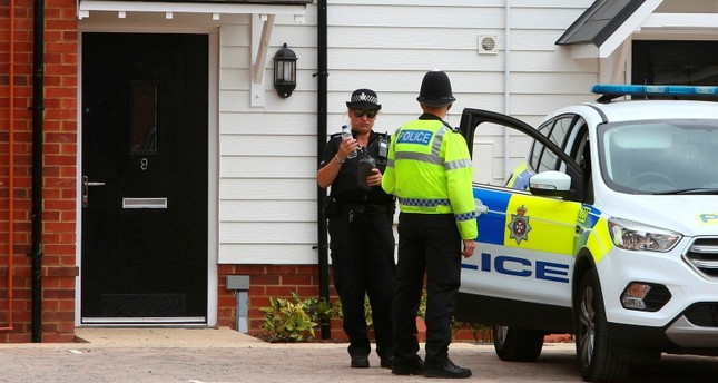 A police officer stands guard outside Charlie Rowley's house in Amesbury, southern England, on July 4, 2018. (AFP Photo)