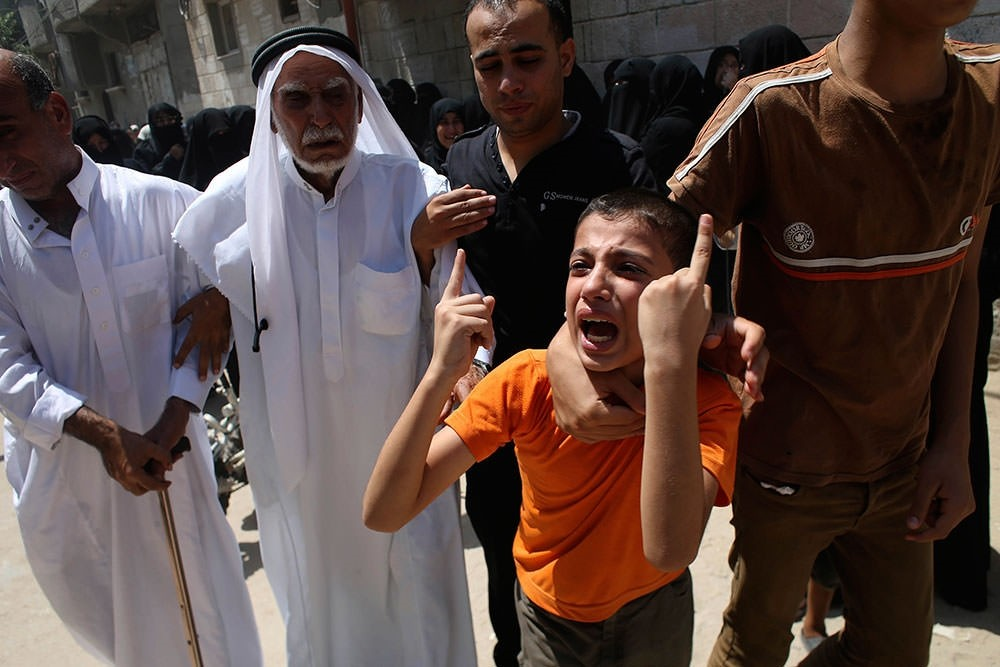 A relative of a Palestinian man killed in an Israeli airstrike mourns during his funeral