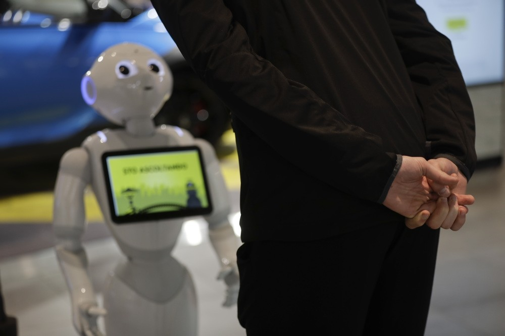 A guest asks robot Robby Pepper for information at the front desk of a hotel in Peschiera del Garda, Italy.