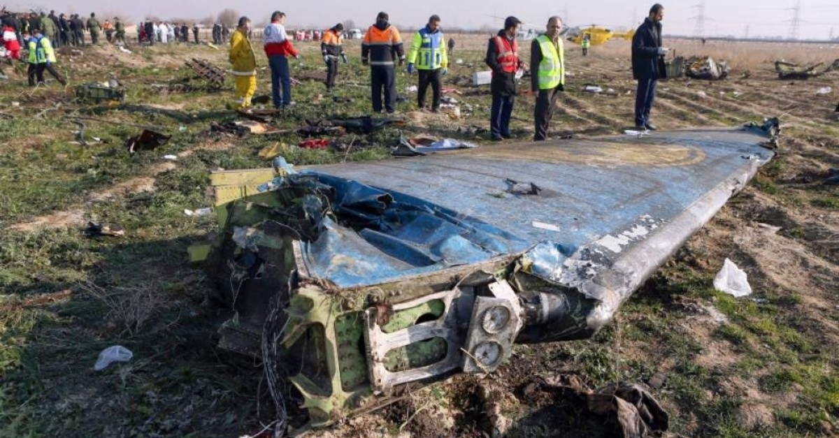 In this file photo taken on January 8, 2020 rescue teams are seen at the scene of a Ukrainian airliner that crashed shortly after take-off near Imam Khomeini airport in the Iranian capital Tehran. (IRNA via AFP)