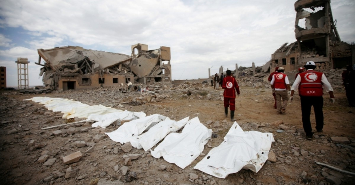 Bodies lie on the ground after being recovered from under the rubble of a Houthi detention center destroyed by Saudi-led airstrikes, in Dhamar province, southwestern Yemen, Sunday, Sept. 1, 2019. (Reuters Photo)