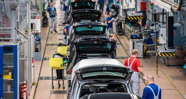 This file photo taken on March 1, 2019 shows an overview of a production line at German car maker Volkswagen's headquarters in Wolfsburg, northern Germany. AFP Photo