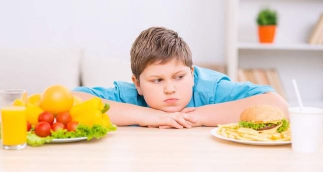 There are various causes of child obesity, including lack of exercise and poor choice of diet. iStock