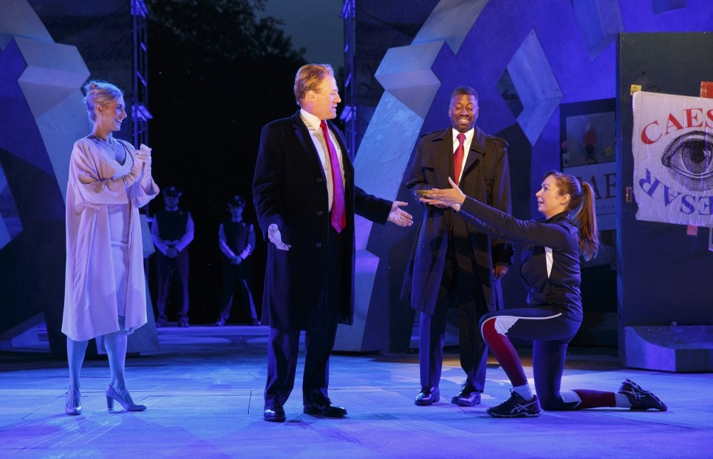 Tina Benko, left, portrays Melania Trump in the role of Caesaru2019s wife, Calpurnia, and Gregg Henry, center left, portrays President Donald Trump in the role of Julius Caesar during a dress rehearsal.