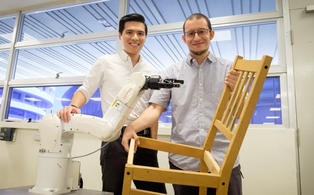 NTU assistant professor Pham Quang Cuong L and research fellow Francisco Suarez-Ruiz pose with an autonomous robotic arm capable of assembling IKEA furniture, Singapore.