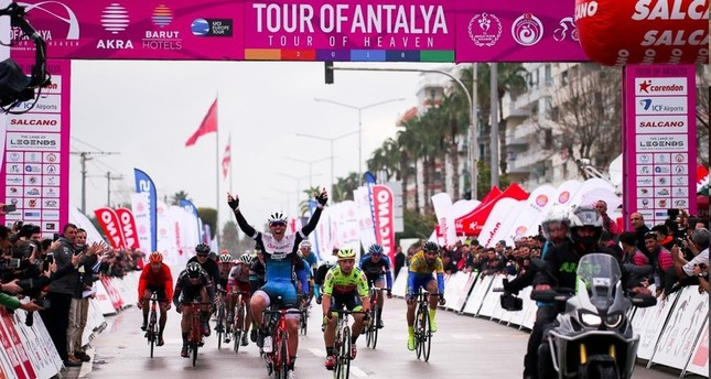 A cyclist cheers as he reaches the finish line in one of the stages in the first edition of Tour of Antalya in 2018. This year's event will bring together cyclists from 21 countries.