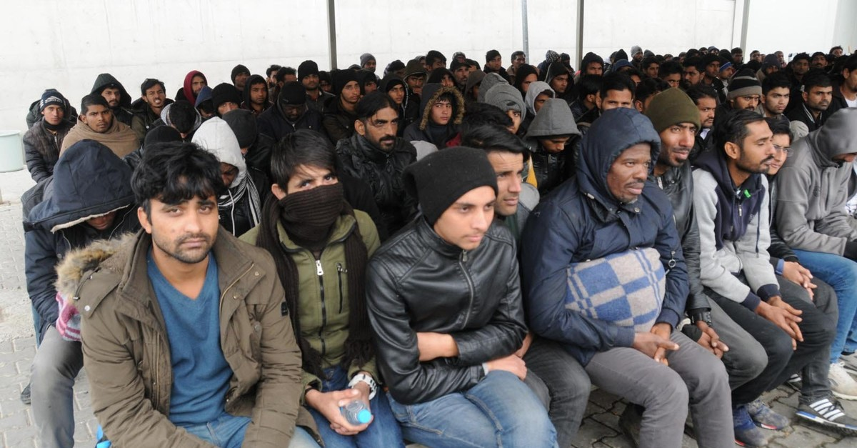 Migrants stopped near the border wait for transfer to a migrant center in Edirne in this undated photo.