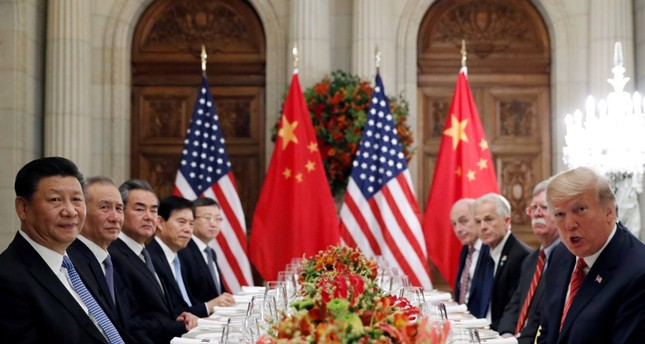 Chinese President Xi Jinping and U.S. President Donald Trump attend a working dinner with their delegation after the G20 summit in Buenos Aries, Argentina, Dec. 1.