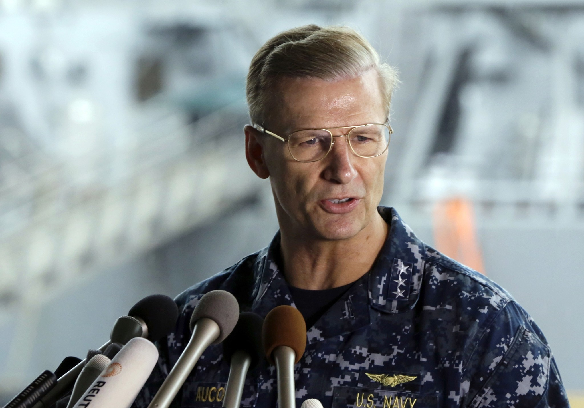 In this June 18, 2017, file photo, U.S. Navy Vice Adm. Joseph Aucoin, Commander of the U.S. 7th Fleet, speaks during a press conference, with damaged USS Fitzgerald as background at the U.S. Naval base in Yokosuka. (AP Photo)