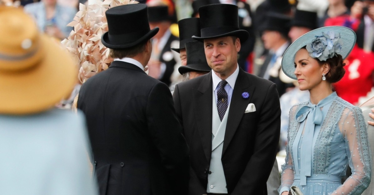 Kate, Duchess of Cambridge, right, and Prince William arrive on the day one of the annual Royal Ascot horse race meeting in Ascot, England, Tuesday, June 18, 2019. (AP Photo)